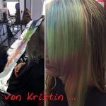 Frau lange Haare mit Rainbow-Strähne. Frisur einer Frau mit langen blonden Haaren und einer Strähne in Rainbow Colour