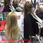 Frau mit langen Haaren Balayage. Frisur einer Frau mit langen blonden Haaren mit Balayage-Technik